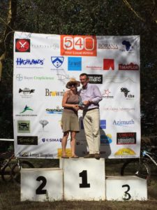 Jude on the top spot of the podium getting her prize from Paul Sherwen