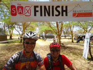 Jon and Jude at the finish line of the 10 to 4 - tired and dusty