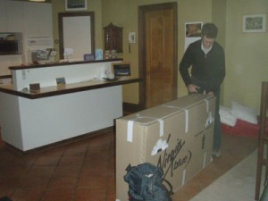 packing up the bike box at home
