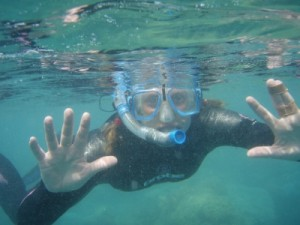 snorkelling to one of the CPs - you can see the 2 fingers still taped together because of a broken index finger