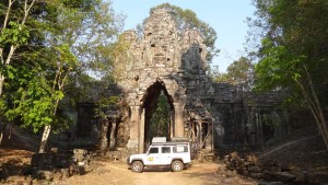 Lara in Cambodia, Siem Reap in front of the little known and little visited East Gate of Angkor Thom.