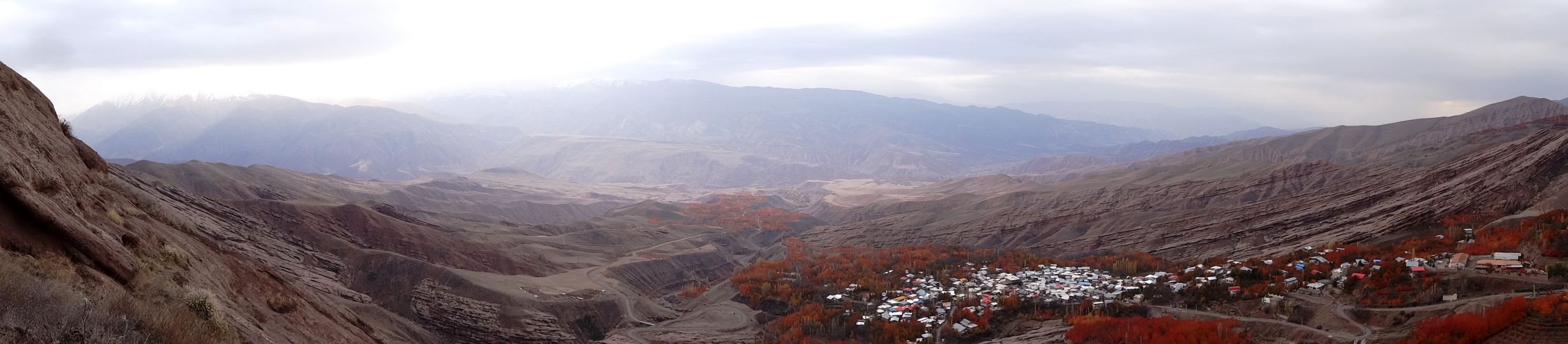 Alamut - view of the cherry trees in beautiful red autumn colours from Alamut Castle