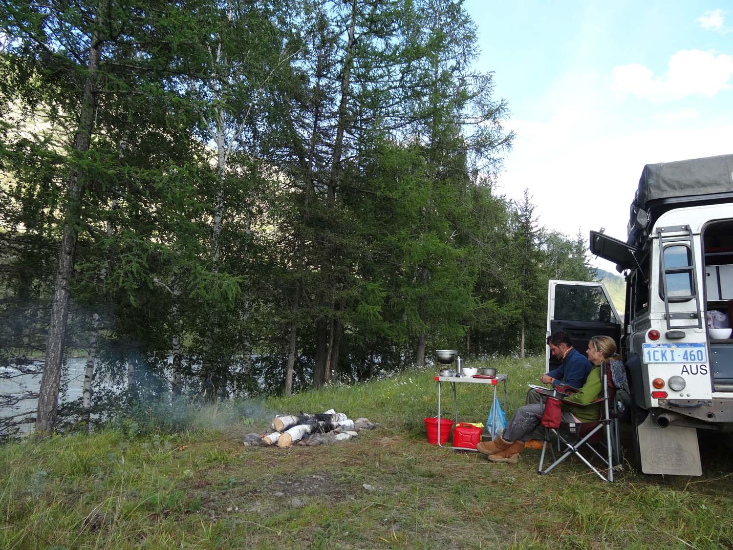 camp fire by the river - great camp site on the chutsky trakt