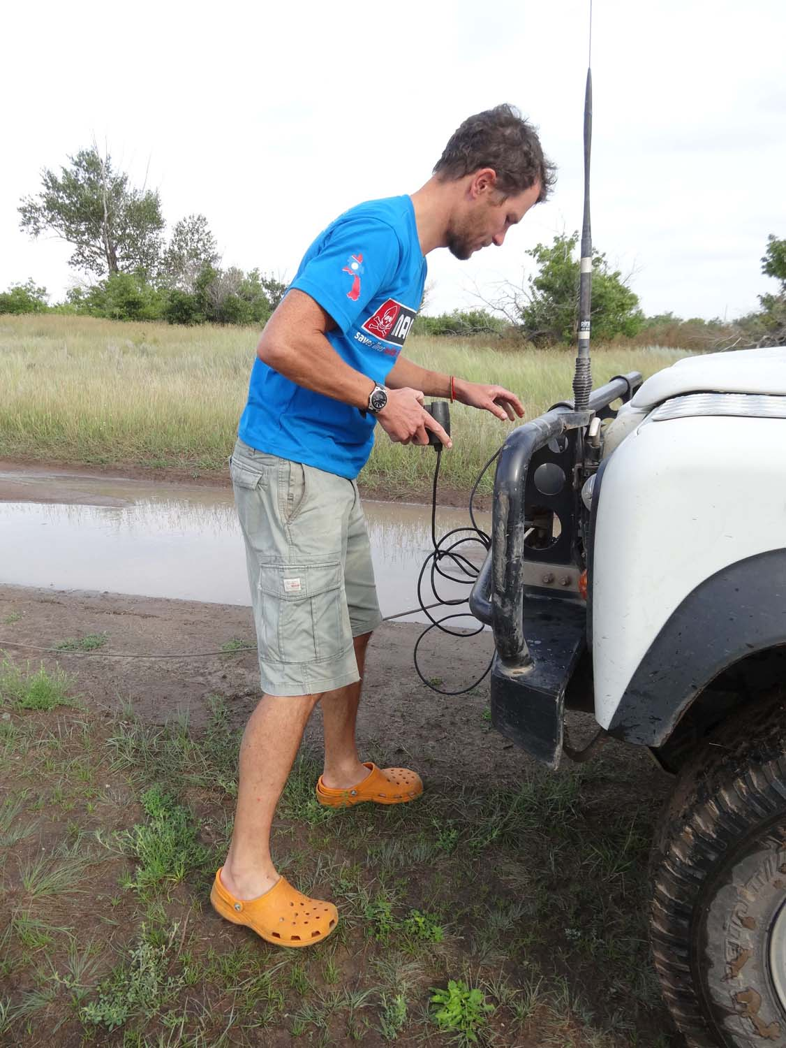 getting the winch ready to pull a local out of the mud