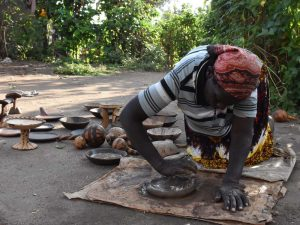 making a clay dish, the Ari people are known for creating the plates to make injera