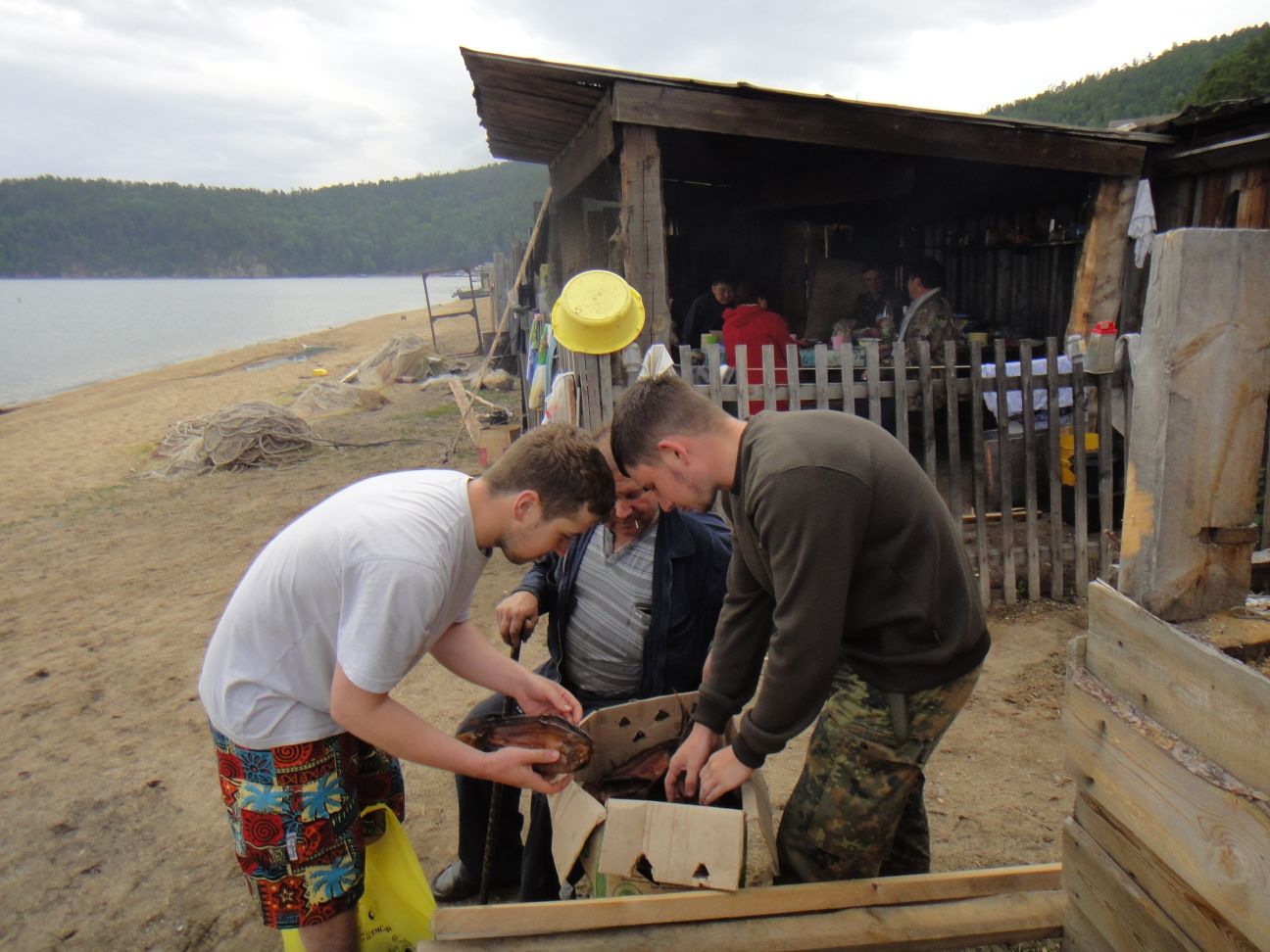 Ivan and Alexander picking the fish for dinner