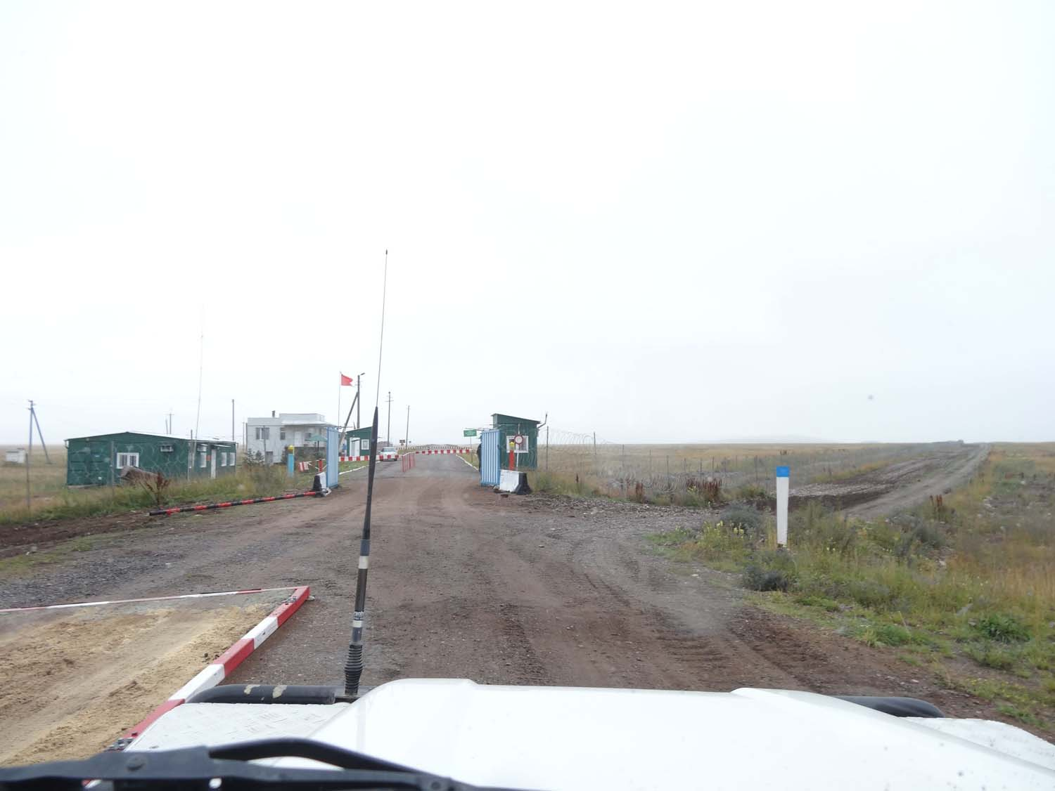 you can just see the sandpit where cars have to drive through going into Kazakhstan. This is the view of the Kyrgyz side of the border post