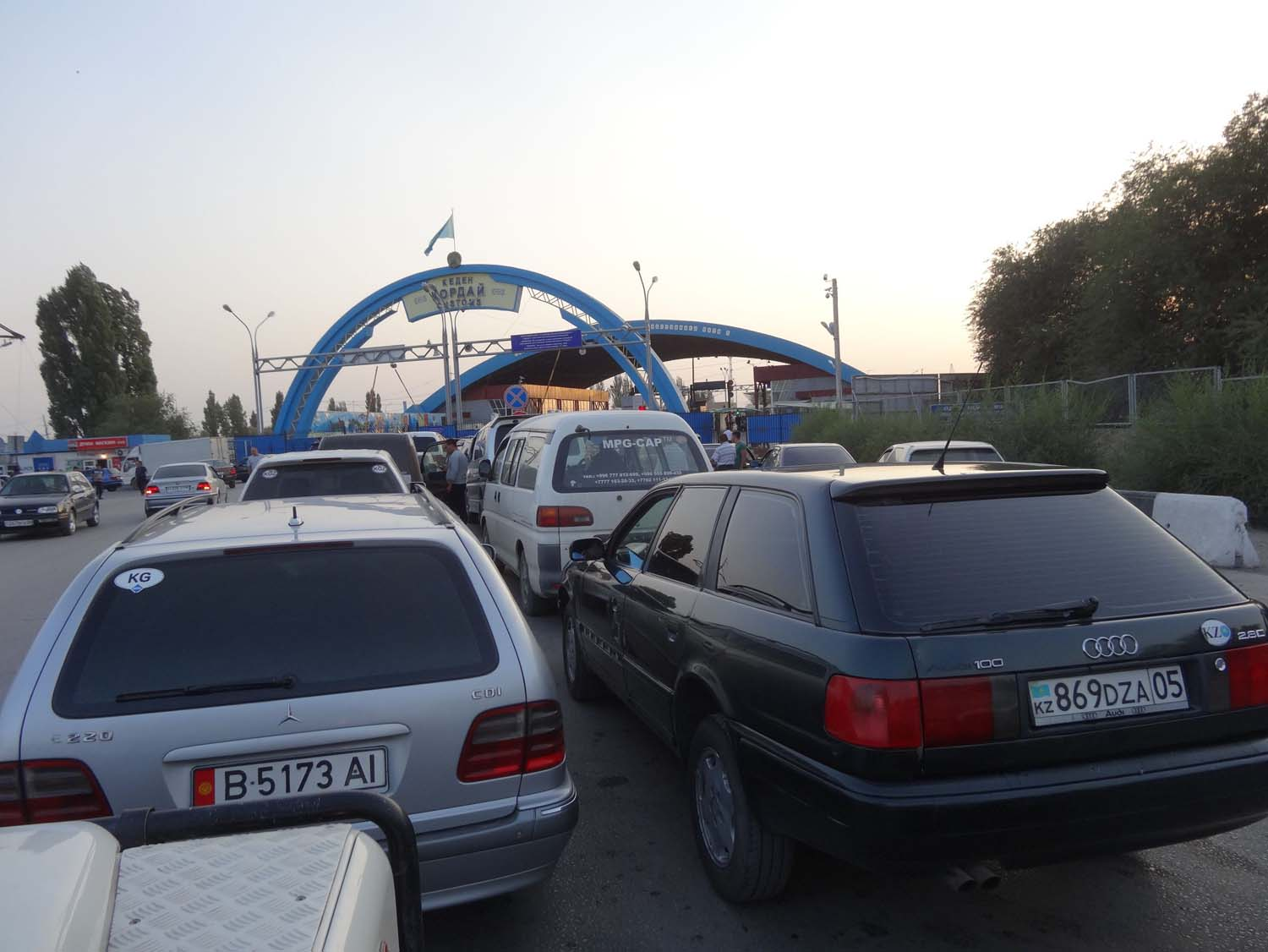 the rows of cars just outside the border from Kazakhstan to Kyrgyzstan (near Bishkek)