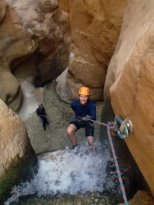 Jon going down one of the waterfalls in Wadi Karak