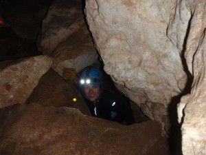 Jude coming out of a tiny hole in Dingo Cave