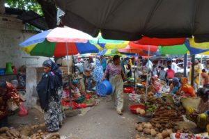local market in the Comoros, if you look carefully you can spot some more ladies with the beauty mask