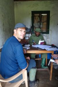 Jon registering our permit to hike up active volcano Nyiragongo
