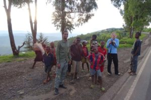 JP makes regular stops on the drive back to Kigali to look for birds, he is very keen to learn all the birds
