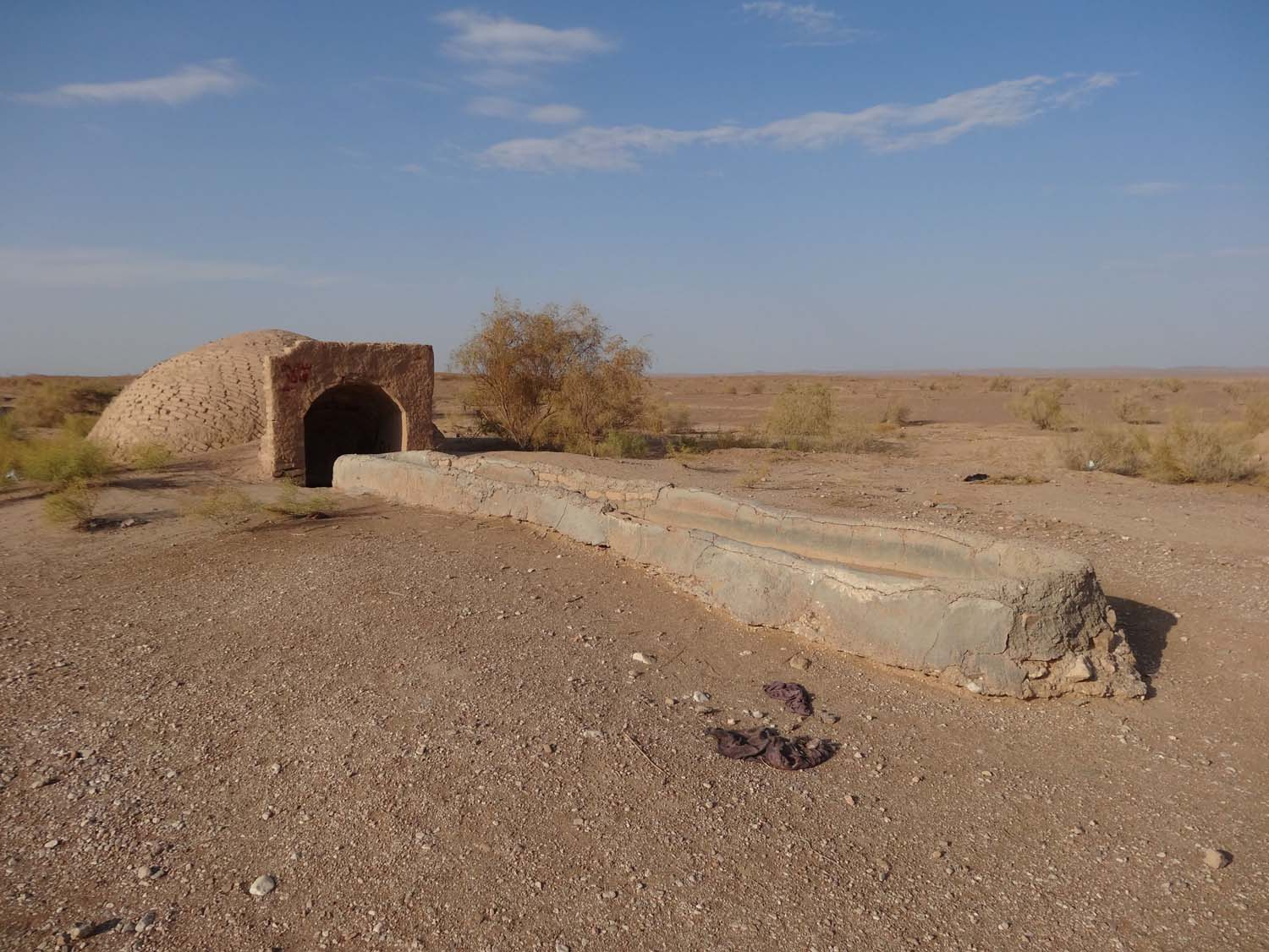 wells in the desert, often linked to the qanats