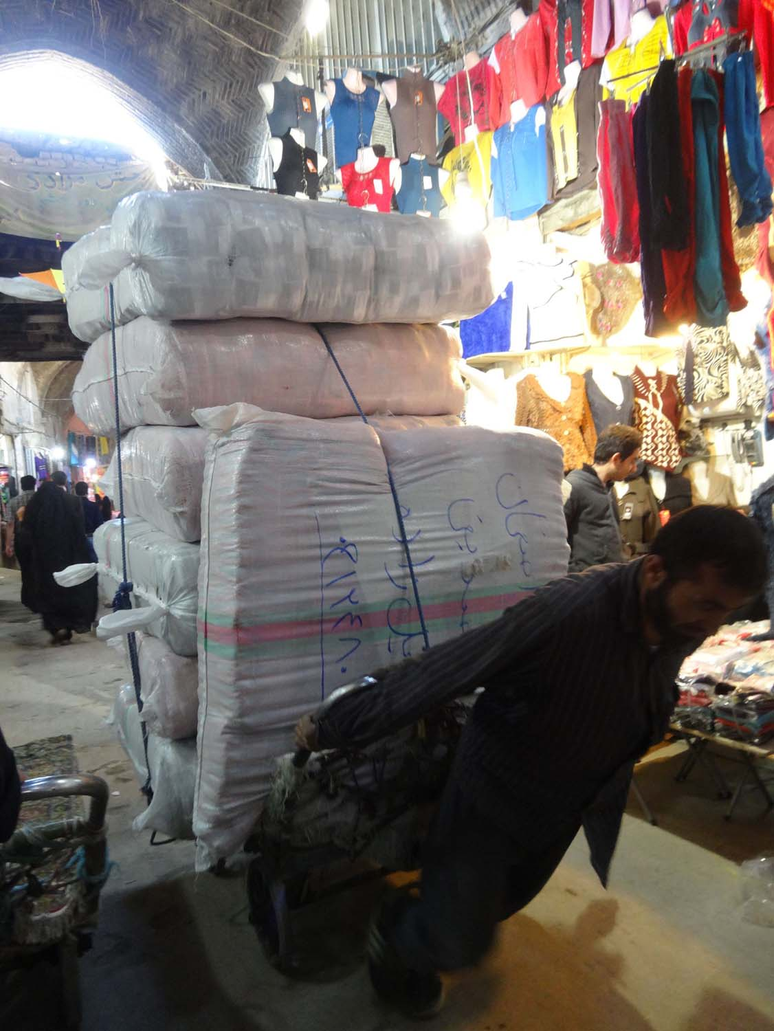 narrow streets in the bazaar means things are carted in by manpower