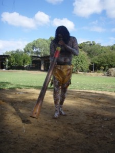 playing the didgeridoo