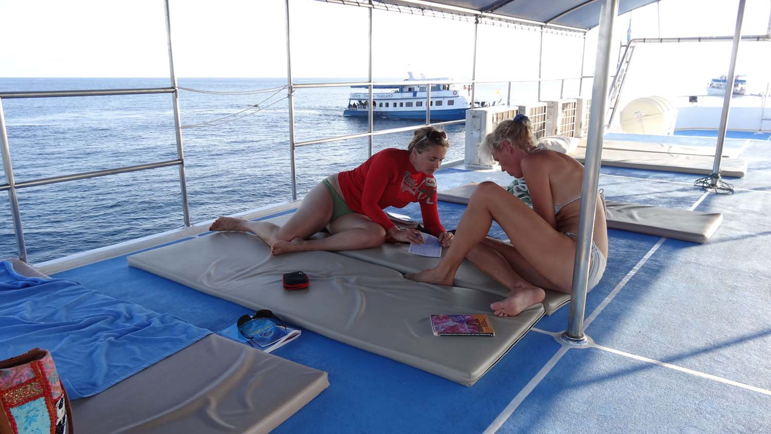 studying hard for our advanced diving certificate on the liveaboard