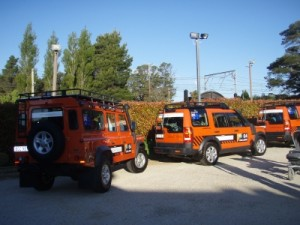 Land Rovers parked outside the hotel where we have some more tests