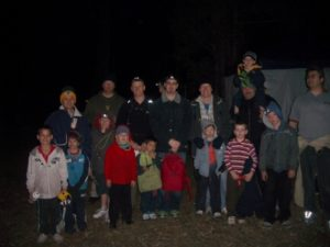 a huge group of fathers and sons enjoying a bonding weekend