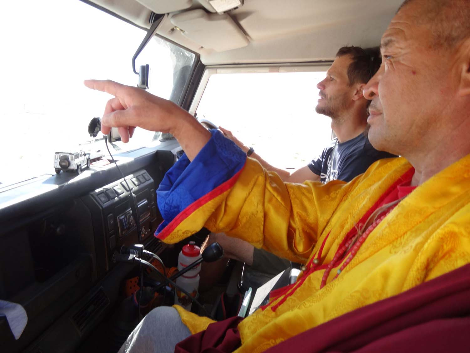 the monk gives direction how to get to his ger - and yes, I am hanging on  whilst Jon drives!