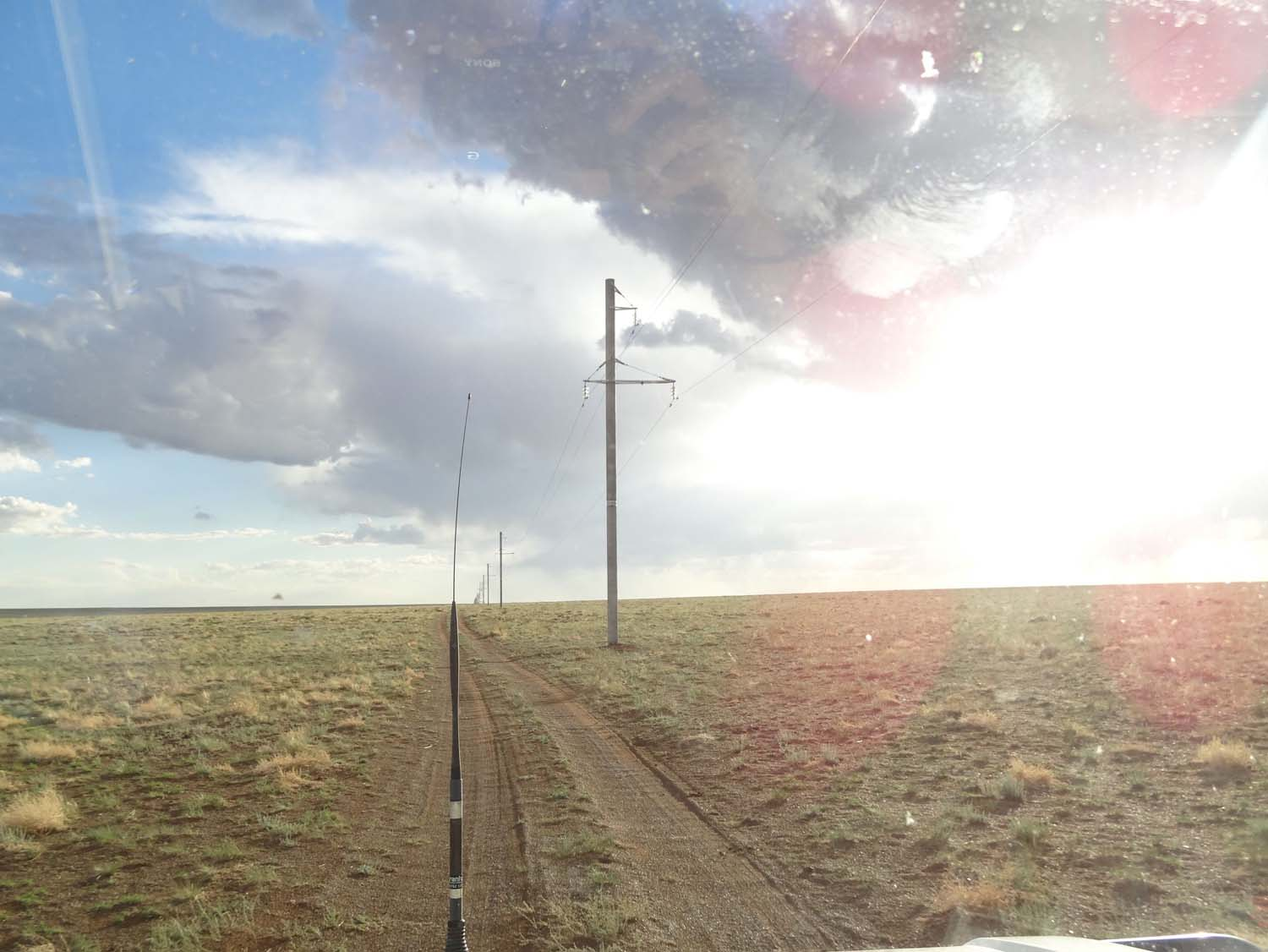 following the tracks next to the telegraph lines in the Gobi