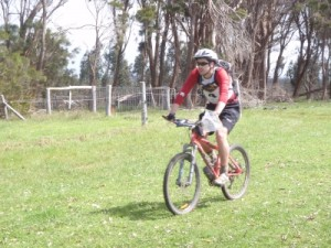 Clayton finishing on the bike