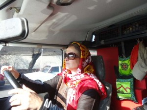 Driving in Iran means driving with a headscarf for Jude.