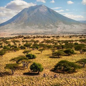 aerial view of Jon and Jude riding through some amazing landscape in the north of Tanzania, in the shadow of Ol Doinyo Lengai