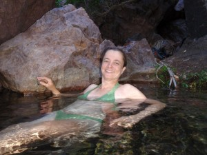 relaxing in the Zebedee Springs on El Questro