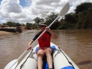 kayaking down the little rapids of the Ewaso Ng'iro