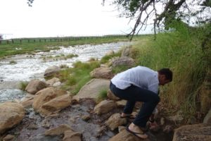Jon checking out the temperature of the hot springs (Maji Moto) in Lake Manyara NP