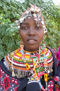 this 14 year old Rendille girl got married a few weeks ago to a 14 year old warrior from her tribe and is therefore still wearing her beautiful decorations. Her 4 month old child hangs on her side, shotgun wedding?