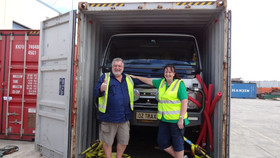 Rob & Robyn with their truck in the container
