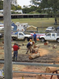 Boonah show - after the chainsaw they hammer in the metal wedges and split the wood into posts