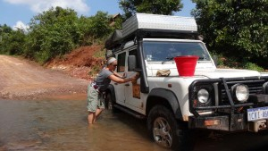 Creek crossings are excellent places to wash Lara. This is in Namtha, Laos.
