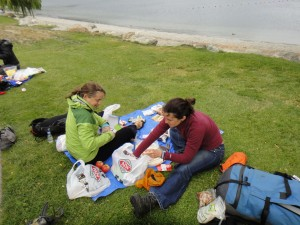 packing our food into our packs at the shores of Lake Wanaka
