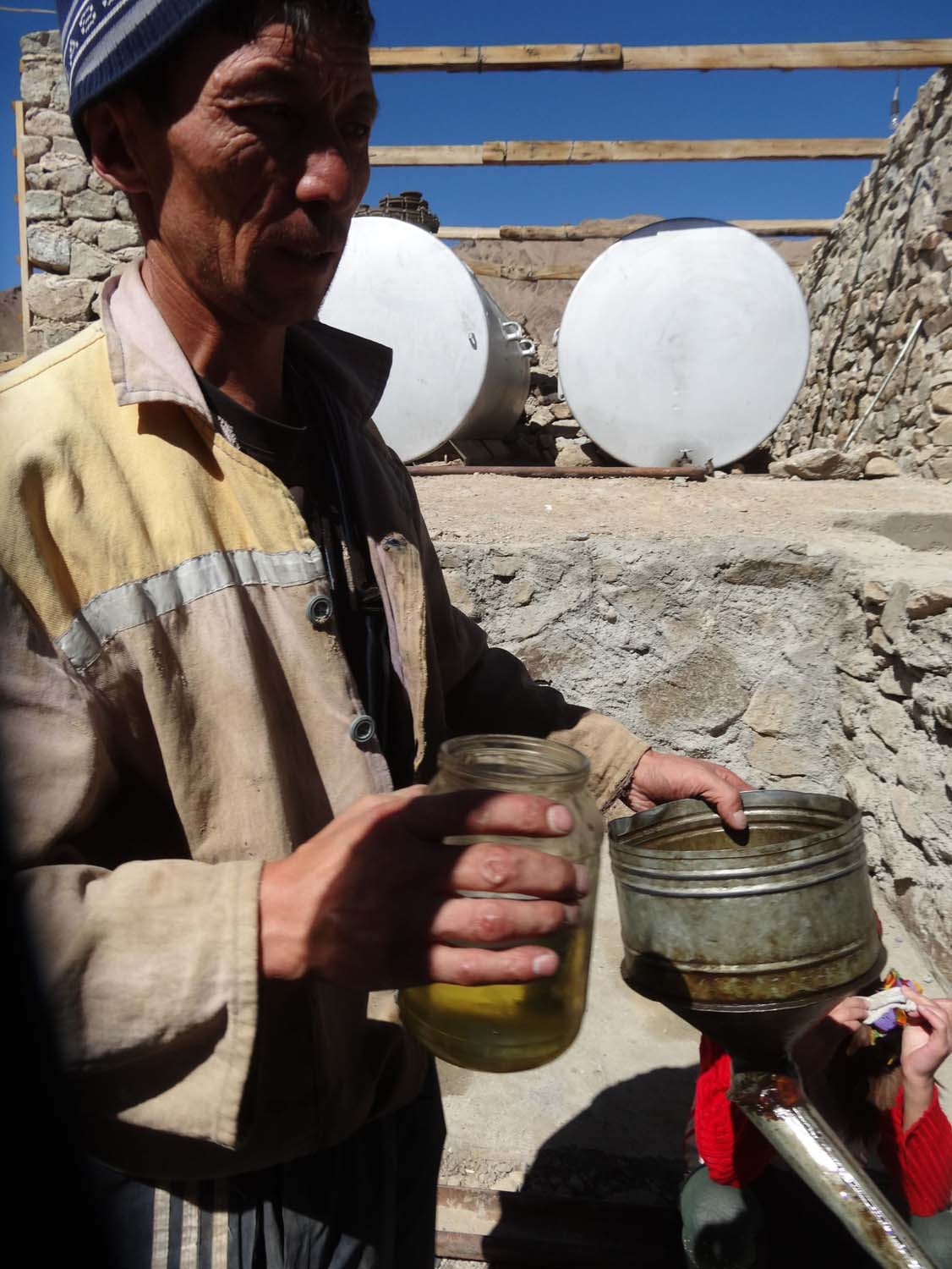 filling up with diesel on the Pamir Highway, this was our change...