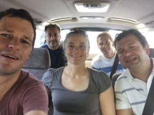 Jon, Tom, Jude, Carl and Karl in the taxi from the airport to the hotel