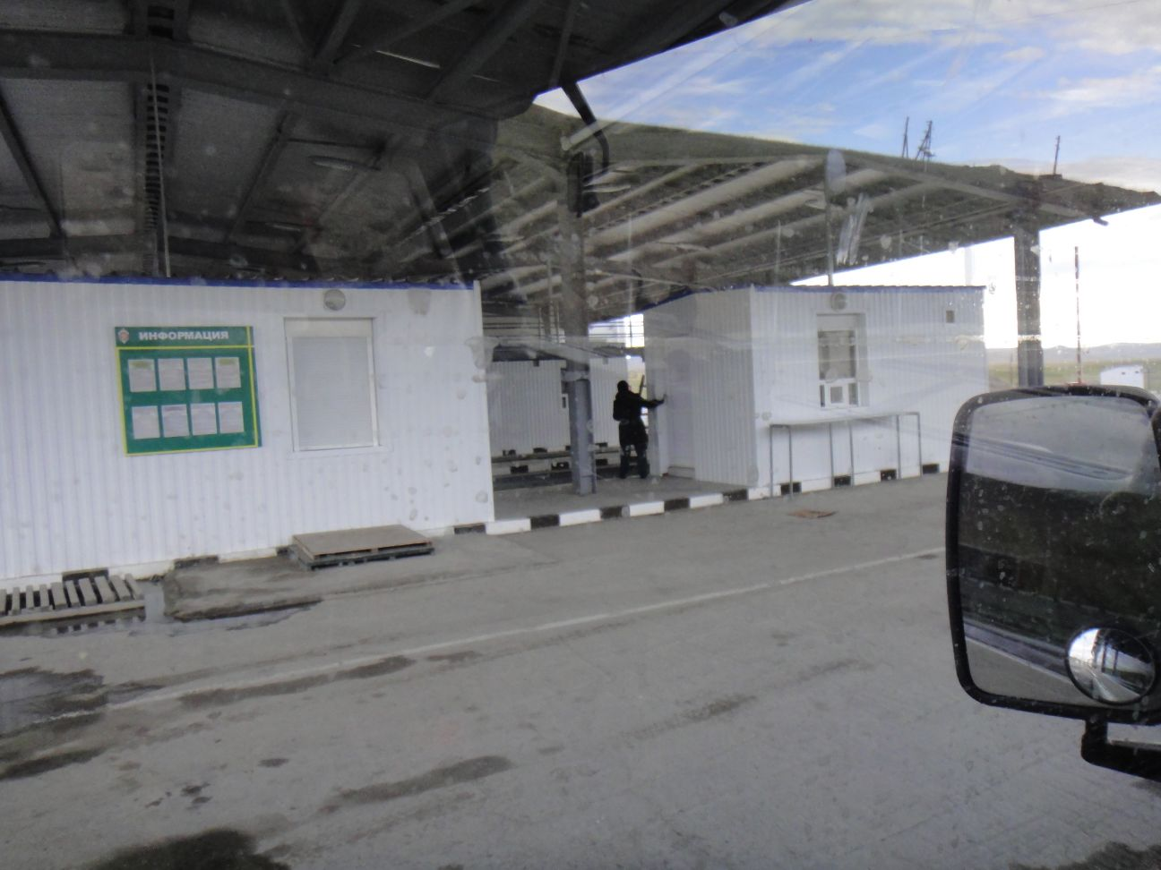 the undercover area with passport control (left)and customs offices (right) visible
