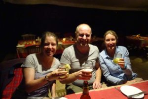 Chaka camp - the ladies drinking 'dawa' - east africa's best medicine, and Mel has a Kilimanjaro beer