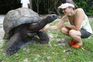 Jude and an Aldabra giant tortoise (they can get up to 255 years old!)