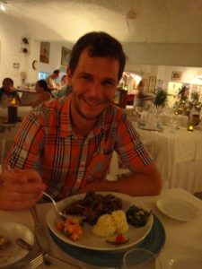 Jon eating the local speciality - fruit bat stew
