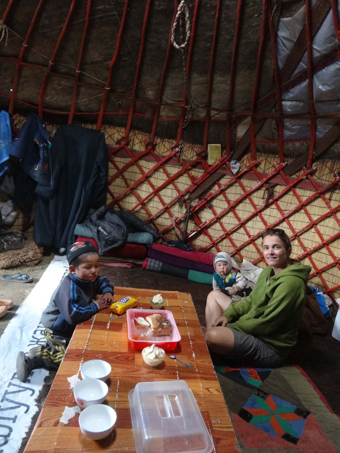 inside a Kyrgyz yurt, sitting on the sheepskin
