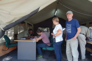Jon filling in the paperwork at Tarangire NP with Nico and Riet waiting