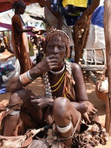 a Hamer lady is trying to sell her wares at a local market