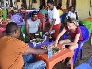 Abiy, Habtamu and Jude eating injera in a local restaurant - delicious