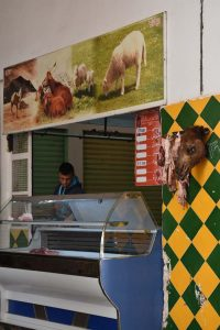 the butcher where we bought the fresh camel meat, note the head hanging next to the shop to indicate what type of meat is for sale