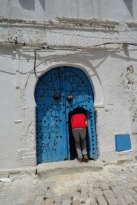 Jon disappearing into a house in the medina in the centre of Tunis