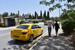 Tim and Martina telling a taxi driver to take a hike as we can walk the few hundred meters to the next Carthage site