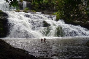 Jon and Jude enjoy a swim in the refreshing waters of the Songo waterfall